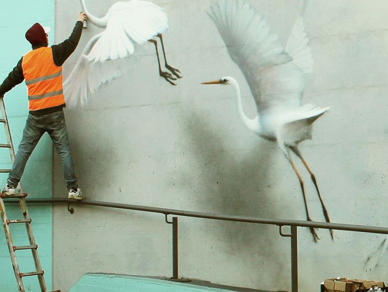 Watch how this street artist turns dull walls into 3D mural masterpieces