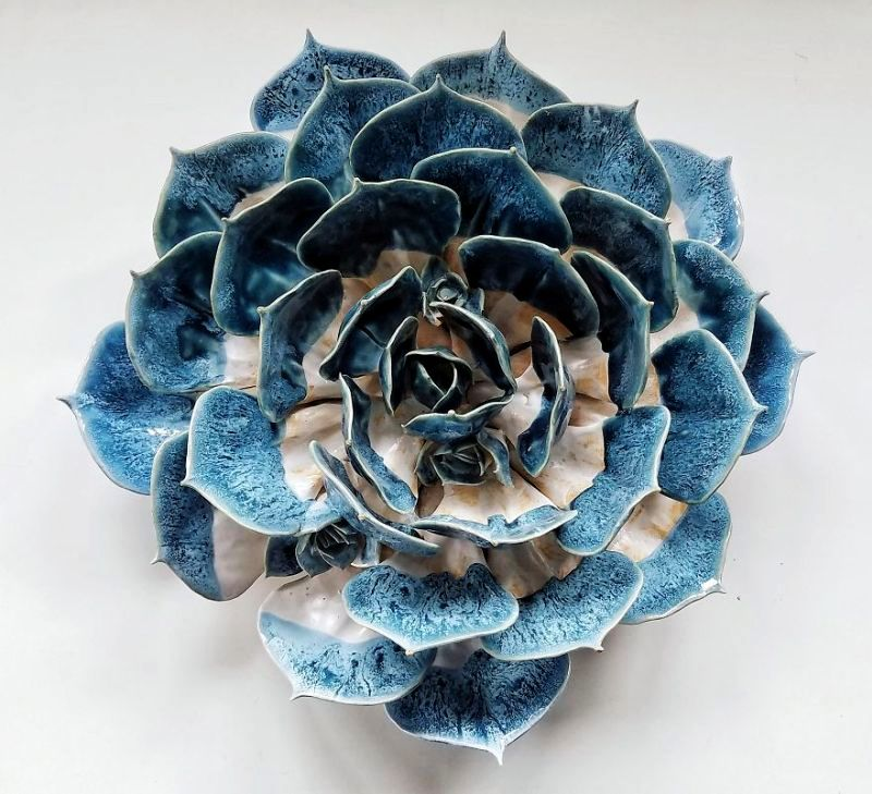 Self-taught sculptor grows succulents using clay and porcelain