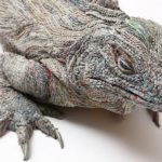 Realistic animal sculptures made from densely rolled newspapers