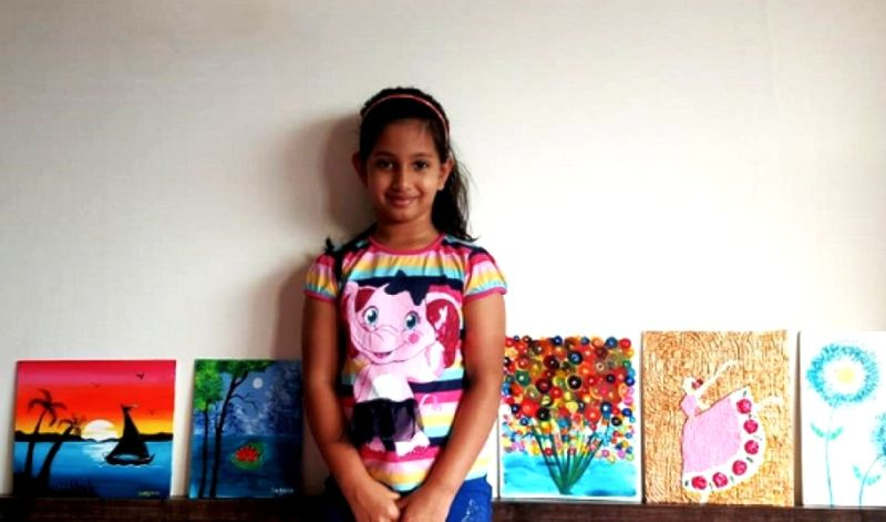 7-year-old girl sells her paintings to fund education for poor kids