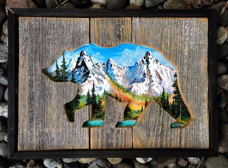 Breathtaking landscapes paintings emerge from intricately carved wood