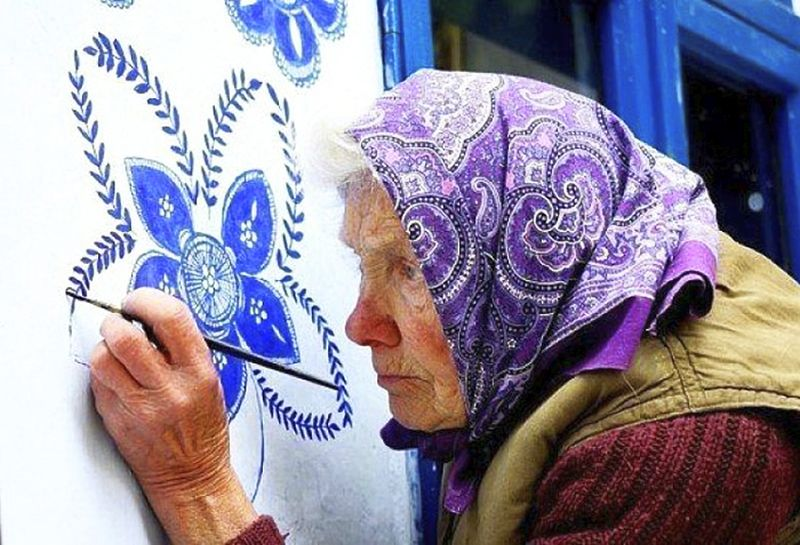 90-year-old woman gives floral makeover to houses in her small village