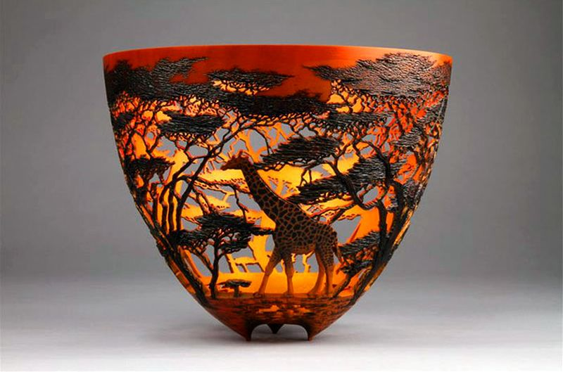 Intricate scenes of wildlife beautifully hand-carved on wooden vessels