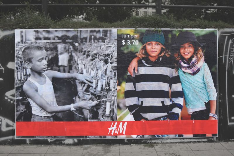 Polish artist creates billboards to show the greed of fashion industries